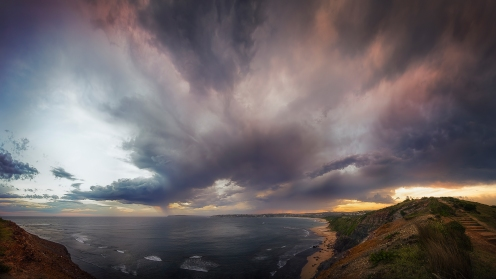 Storm clouds over Long Reef Headland